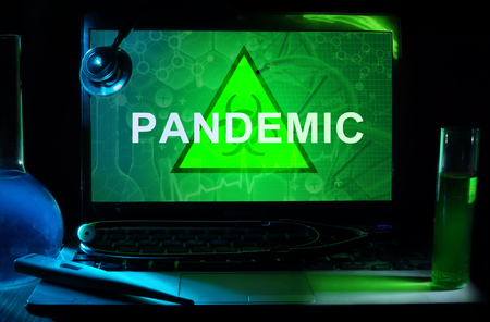 Notebook with words  pandemic Stock Photo