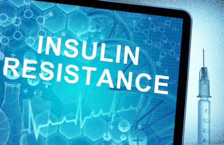 insulin syringe: the words  Insulin Resistance on a tablet with syringe