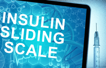 sliding scale: the words  insulin sliding scale on a tablet with syringe Stock Photo