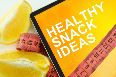 healthy snack: Tablet with words healthy snack ideas and measuring tape