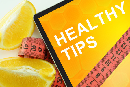 tip: Tablet with words healthy tips and measuring tape