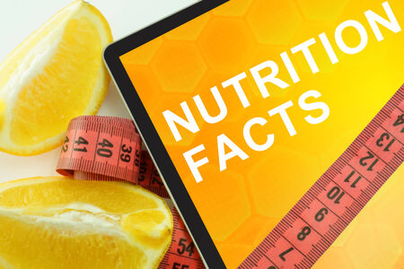 Tablet with words nutrition facts and measuring tape photo