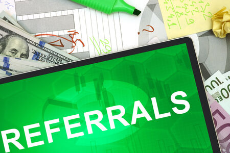 referrals: Tablet with words Referrals with dollars and euro.