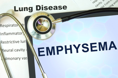 medical abstract: Tablet with word Emphysema and stethoscope. lung disease concept.