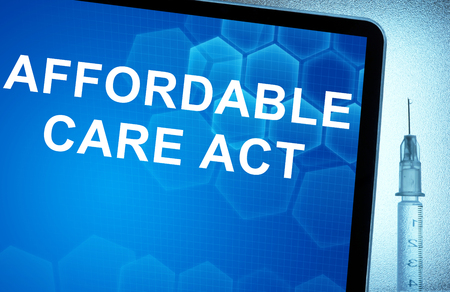 repeal: Tablet with words  Affordable Care Act and syringe