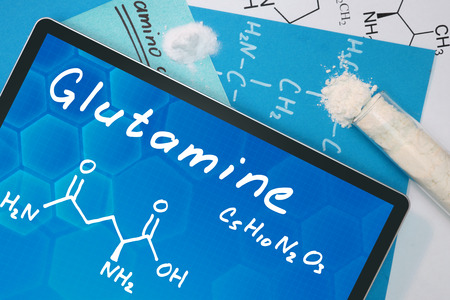 Tablet with the chemical formula of Glutamine . photo