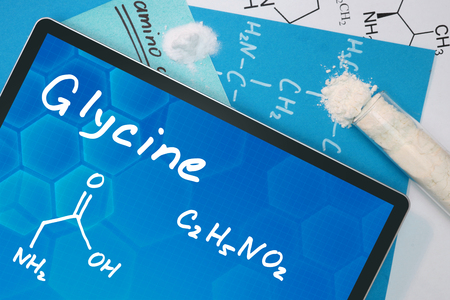 glycine: Tablet with the chemical formula of Glycine .