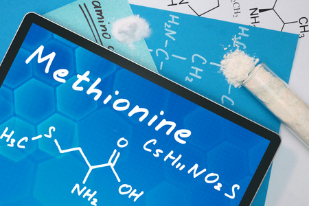 Tablet with the chemical formula of Methionine . photo