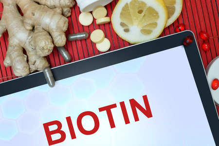 biotin: Tablet with words Biotin. Healthy eating.