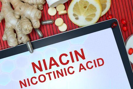 nicotinic: Tablet with words Nicotinic acid (niacin). Healthy eating.