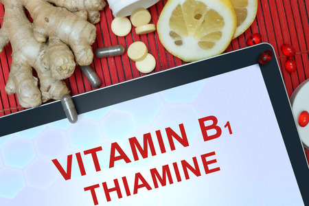 b1: Tablet with words Thiamine (vitamin B1). Healthy eating. Stock Photo