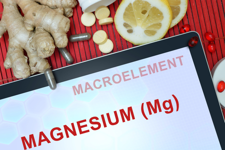 magnesium: Tablet with words Magnesium (Mg). Healthy eating. Stock Photo