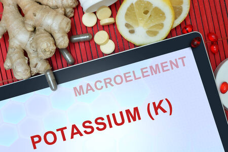 Tablet with words Potassium (K). Healthy eating.