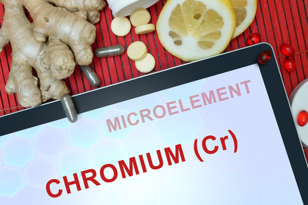 cr: Tablet with words Chromium (Cr). Healthy eating.