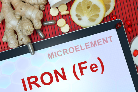 iron: Tablet with words Iron (Fe). Healthy eating.