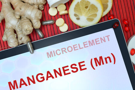 mn: Tablet with words Manganese (Mn). Healthy eating.
