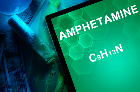 amphetamine: Tablet with the chemical formula of Amphetamine. Drugs and Narcotics