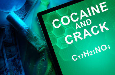 narcotics: Tablet with the chemical formula of Cocaine and crack. Drugs and Narcotics Stock Photo