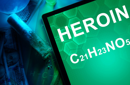 narcotics: Tablet with the chemical formula of heroin. Drugs and Narcotics Stock Photo