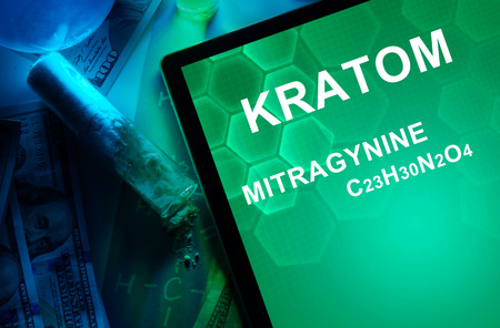 Tablet with the chemical formula of Kratom (Mitragyna speciosa) Mitragynine. Drugs and Narcotics