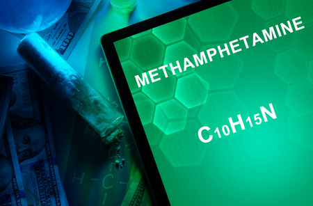 methamphetamine: Tablet with the chemical formula of Methamphetamine. Drugs and Narcotics Stock Photo