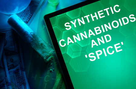 psychoactive: Tablet with the chemical formula of Synthetic cannabinoids and Spice. Drugs and Narcotics Stock Photo