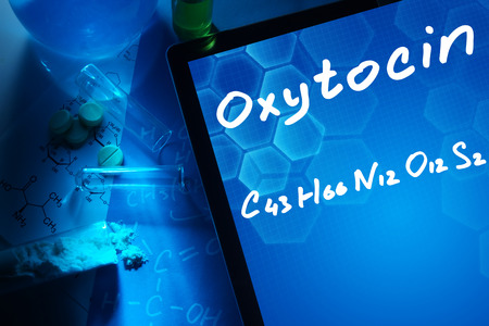 hormone: Tablet with the chemical formula of Oxytocin. Stock Photo