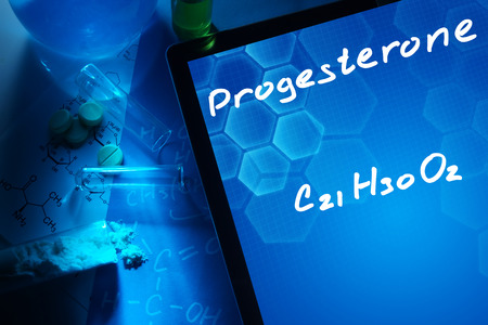 progesterone: Tablet with the chemical formula of progesterone.
