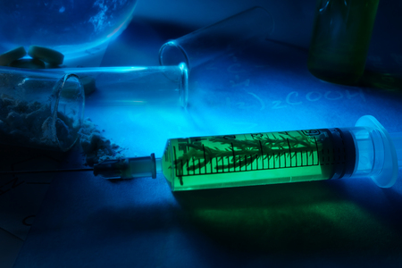 herbology: Syringe with herbs,Test tubes and pills. Stock Photo