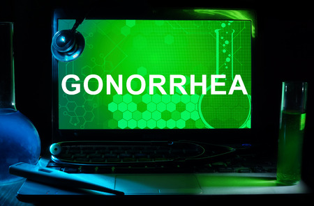 infectious: Computer with word Gonorrhea. Stock Photo