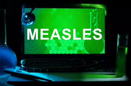 measles: Computer with word Measles.