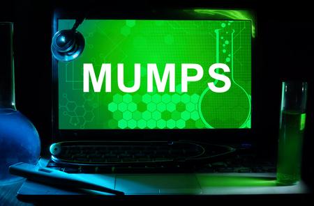 mumps: Computer with word Mumps.