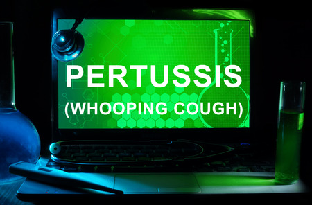 whooping: Computer with words Pertussis (Whooping cough).