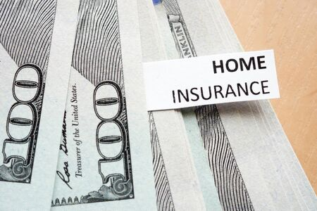 collisions: Paper with words home insurance and money. Stock Photo