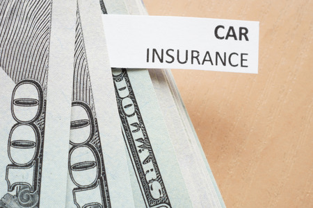 accident rate: Paper with words car insurance and money.