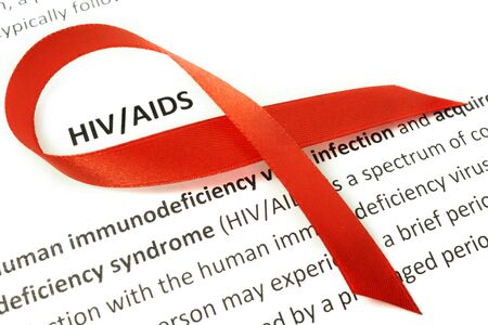 aids symbol: Paper with Hiv aids and red ribbon Stock Photo