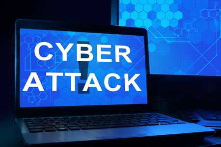cyber defence: Computer with words cyber attack.
