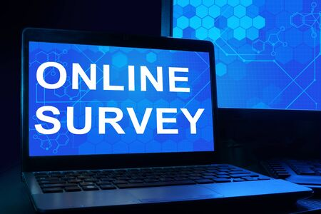 online survey: Computer with words online survey.