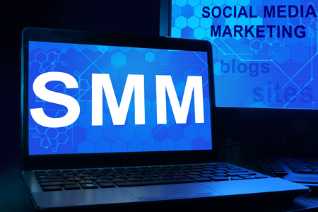 smm: Computer with words Social Media Marketing (SMM). Stock Photo