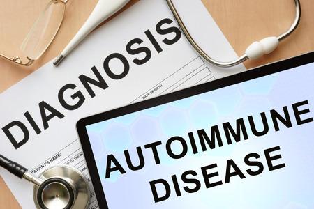 autoimmune: Tablet with diagnosis autoimmune disease  and stethoscope. Stock Photo