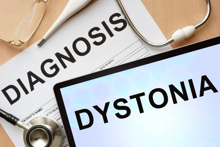 neurosis: Tablet with diagnosis dystonia  and stethoscope.
