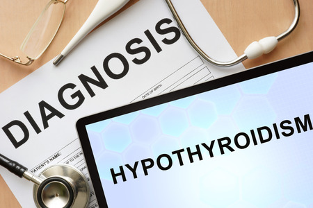 hypothyroidism: Tablet with diagnosis hypothyroidism and stethoscope.