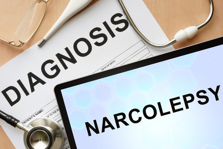 drowsiness: Tablet with diagnosis narcolepsy and stethoscope.