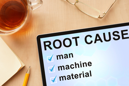 cause: Tablet with words root cause analysis. Stock Photo