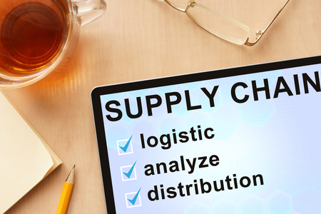 retail chain: Tablet with words   supply chain management. Stock Photo