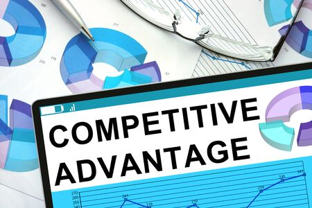 competitive business: Competitive Advantage  on tablet with graphs.