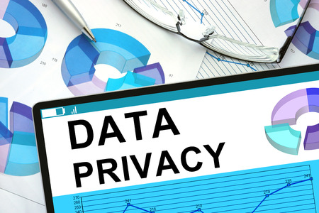 private information: Data Privacy  on tablet with graphs.