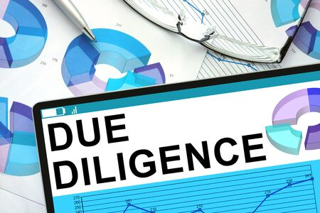 due: Due Diligence  on tablet with graphs.