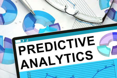 Predictive Analytics  on tablet with graphs. Stockfoto