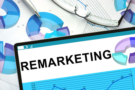 refurbishment: Remarketing  on tablet with graphs. Stock Photo
